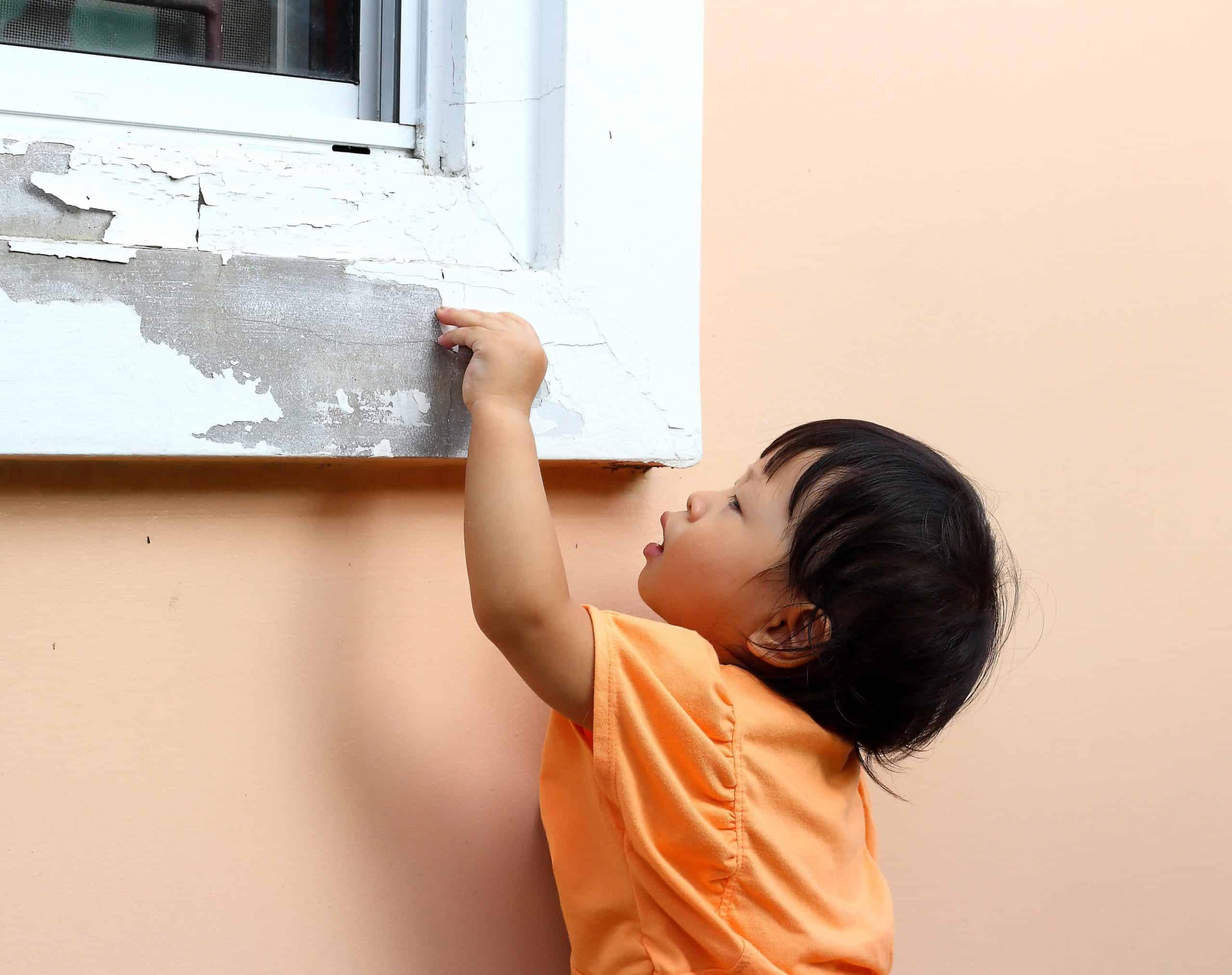 kid peeling lead paint