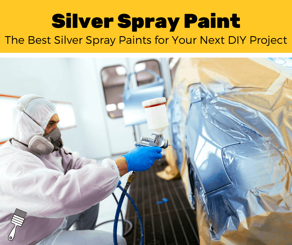 Man spraying silver spray paint onto a car