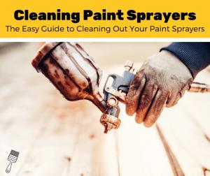 Man holding a dirty paint sprayer